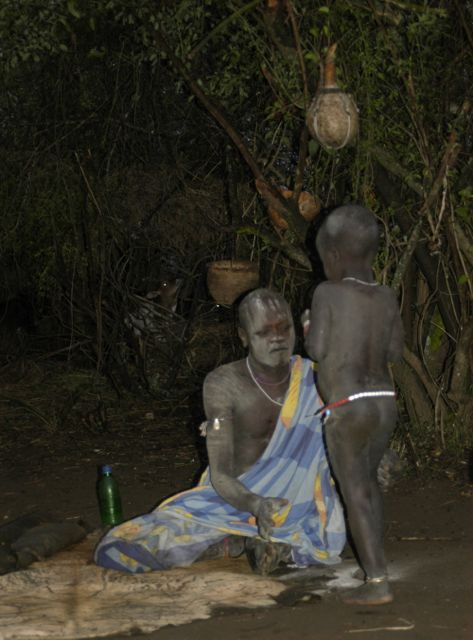 Mursi man and son - body painting is also common