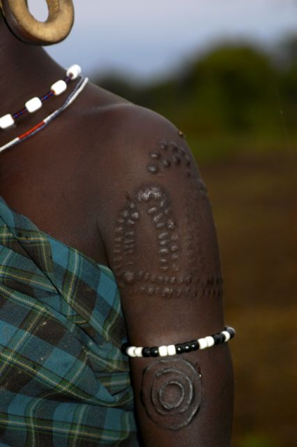 Mursi woman - body scarification is common and she is also wearing an ear disc