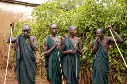 Surma men - note their dangling ears - they often wear ear plates and the sticks are very important. Stick fighting is an important cultural activity.