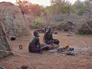 Mursi women around their fire
