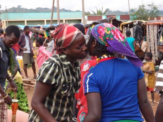 Jinka market - traditional Ari greeting