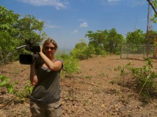 Camerawoman - on the top of Benin's tallest mountain