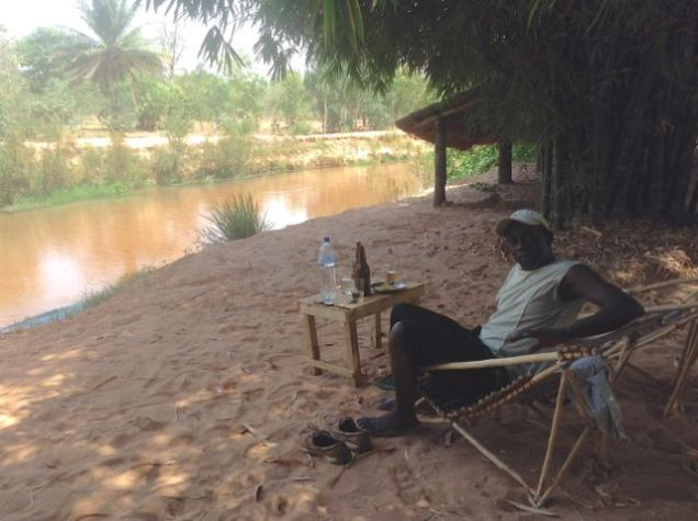 Thomas at our riverside picnic in Bobo, Burkina