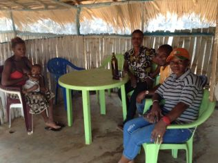 Germaine (in orange hat) and friends in her bar